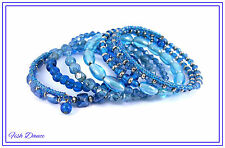 PRETTY MULTI COIL MEMORY WIRE BRACELET WITH BLUE GLASS BEADS & SILVER SPACERS.