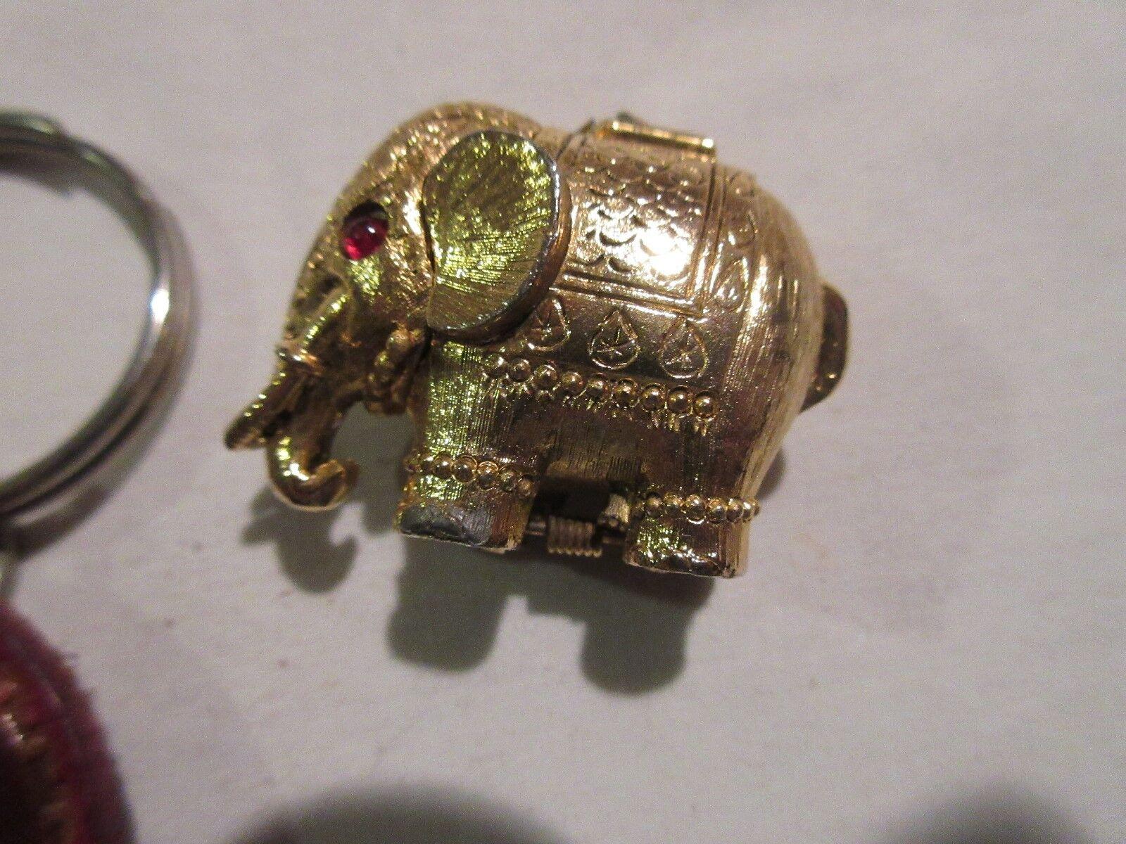 Jewerly, 1 Pin , 1 Keychain , and 1 Elephant Pendant ,