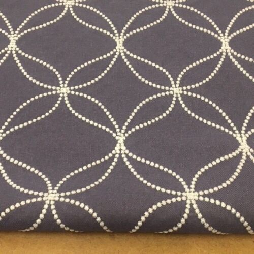 WHITE EMBROIDERY ON BLUE JACQUARD CURTAIN BLIND UPHOLSTERY FABRIC.