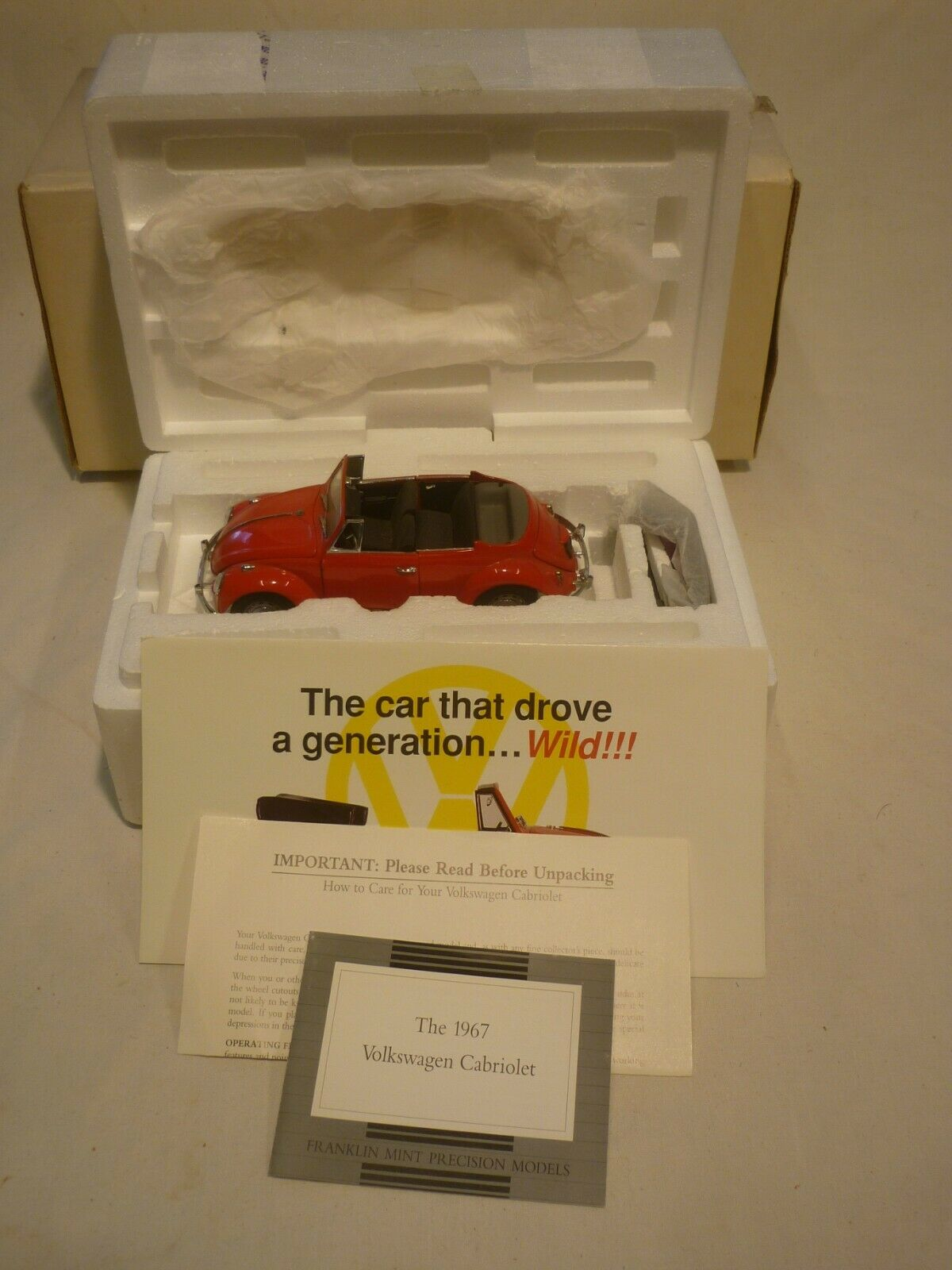 A Franklin mint scale model of a 1967 Volkswagen Beetle congreenible, boxed