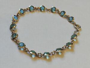 Bracelet-femme-en-argent-massif-et-pierres-bleues