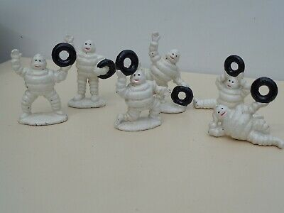 6x Michelin Men Figures playing with their tyres