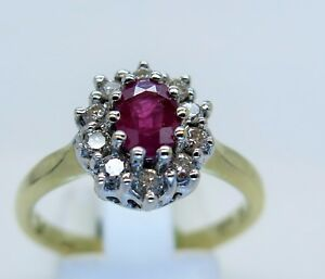 18ct-yellow-gold-Ruby-and-Diamond-Oval-Cluster-Ring-0-50ct-diamond-size-P