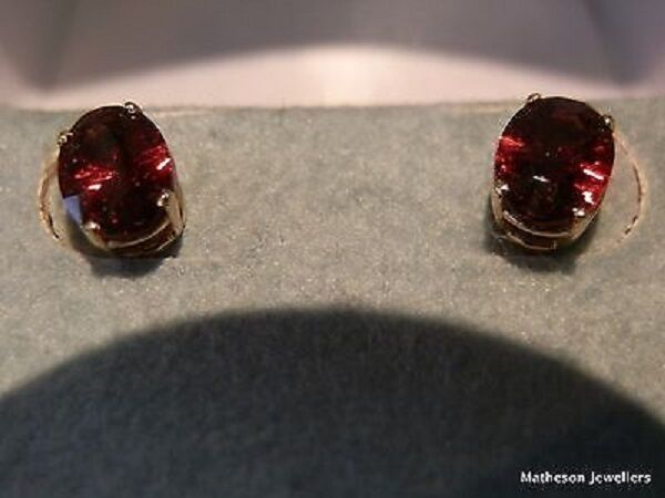 5.Oval. 7x5 mm Garnet, 10K Y  stud earrings.