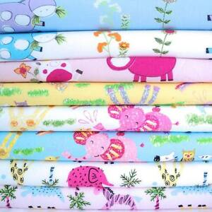 CHILDRENS-NURSERY-ANIMAL-PRINTS-100-COTTON-FABRIC-baby-boy-girl-white-blue-pink