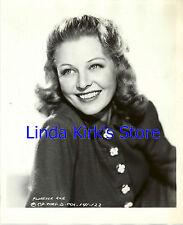 Florence Rice Promotional Photograph Head Shot Smiling Fleu De Lis Buttons