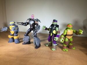 Lot Of 4 Tmnt 2012 Viacom Mikey Tech Donny Metal Head