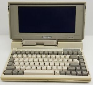 Toshiba T1200 Portable Computer.MS-DOS era.3,5 inch diskdrive.LCD screen. Repair
