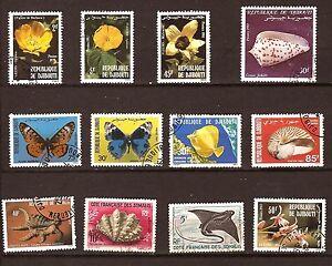9T2-DIBOUTI-Flores-Conchas-Peces-Papillons-12-Sellos-matasellados