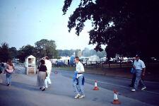 Vintage Kodachrome Slide Negative People On Street Crossing Road Near A Fun Fair