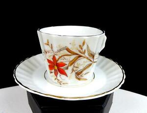 "ENGLISH PORCELAIN RED FLORAL GOLD TRIM RIBBED 2"" DEMITASSE CUP AND SAUCER"
