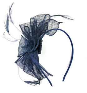 suitable for races, Green net and feather hair fascinator on a slim alice band
