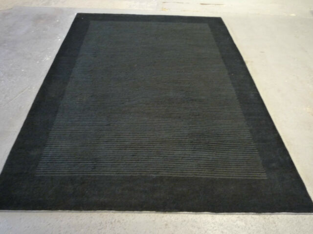 "Stylish black Indo-Tibetan handwoven carpet ( 7ft.8"" x 5ft.8"" )"