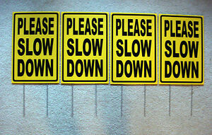 (4) PLEASE SLOW DOWN Coroplast SIGNS with stakes 12x18