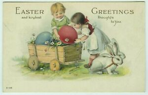 Easter-Wooden-Wagon-Pulled-by-Rabbits-Children-Colored-Eggs-c1910-Postcard