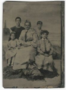 Well-Dressed-Family-Lighthouse-Beach-amp-Wave-Backdrop-Victorian-Studio-Tintype