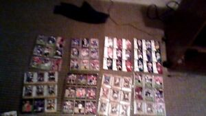 a huge football colloection of cards 122 folder filled with cards plus 13 fahead