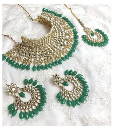 Indian Bollywood Designer Kundan Jewellery Set with tikka gold and green bridal
