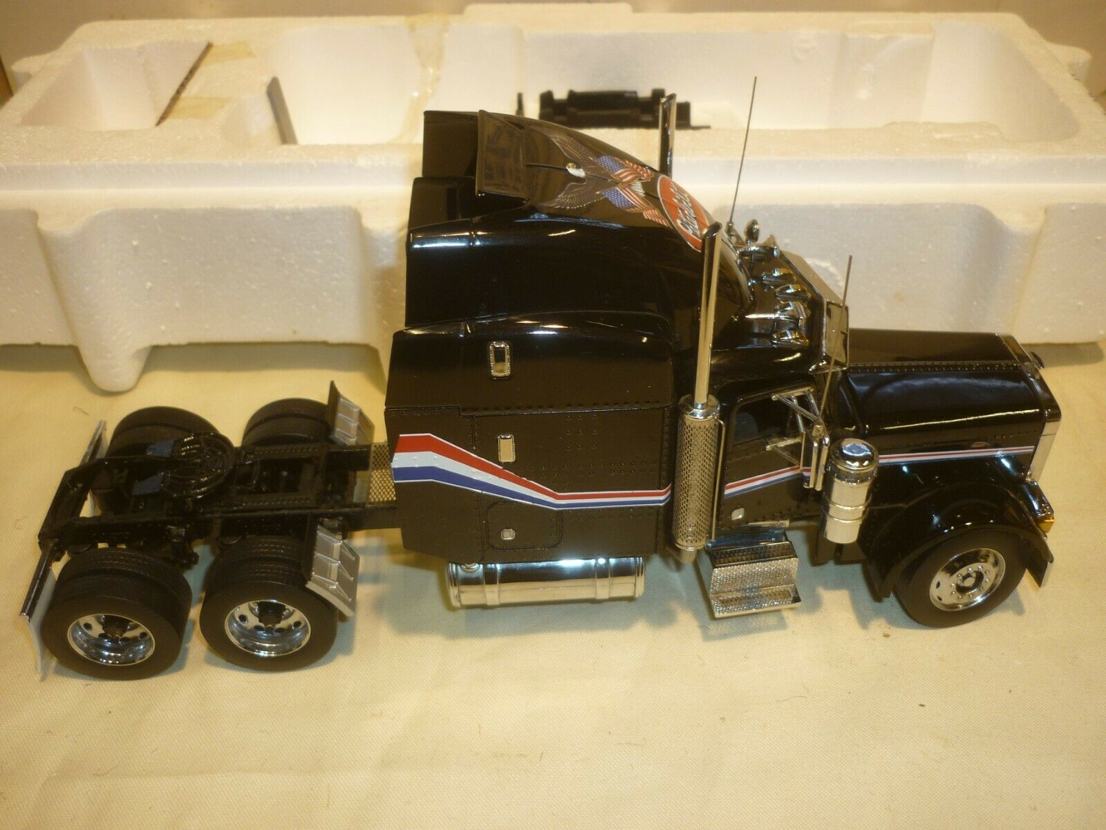 A Franklin mint of a scale model of a Peterbilt 379 & reefer trailer.