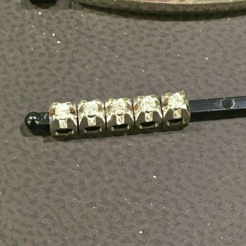 Griffe in oro bianco con diamante 0.02ct ELEMENTS di DonnaOro UomOro DCHF3302