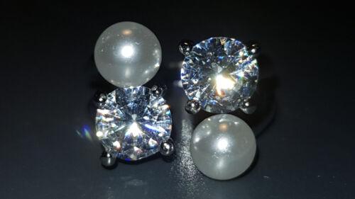 La moderna ajustable anillo con dos perlas y pedrería