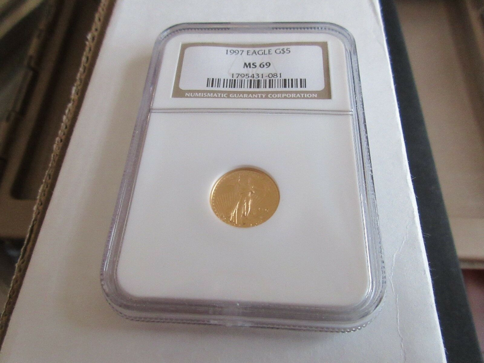 1997 , Eagle , G5$ , NGC , MS 69 , Tenth-Ounce Gold Ame