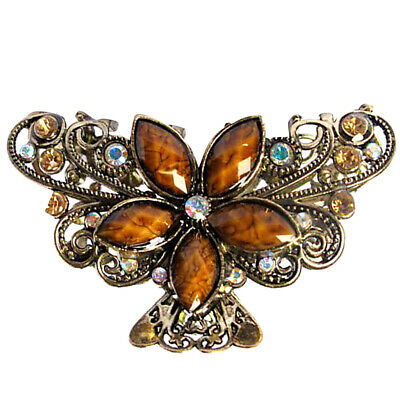 A Stunning Metal Flower And Butterfly Claw Clip With Amber Crystals
