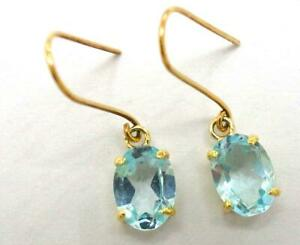 Details About Syjewellery 9ct Yellow Gold Oval Natural Blue Topaz Earrings E803