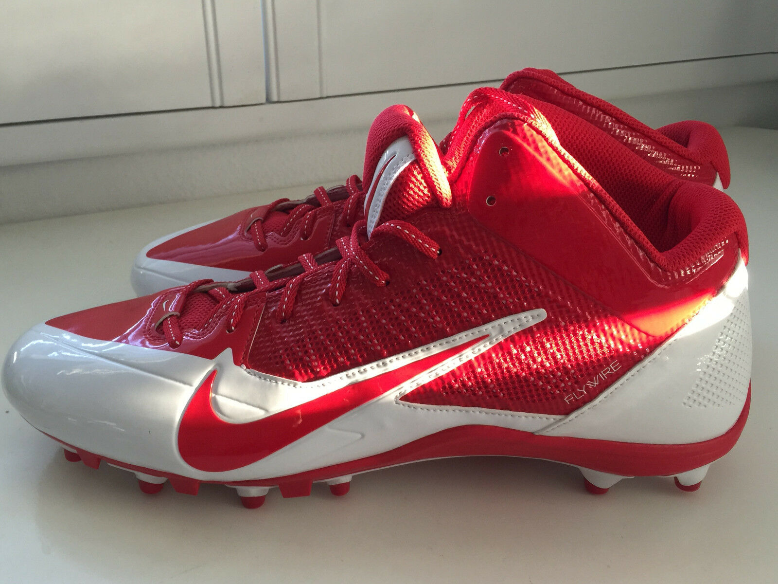 NIKE RED AND CLEATS WHITE  FOOTBALL CLEATS AND SIZE 16 e70625