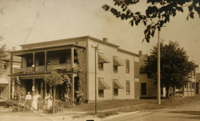 Family Posing Outside Victorian Home w/ Window Awnings ...