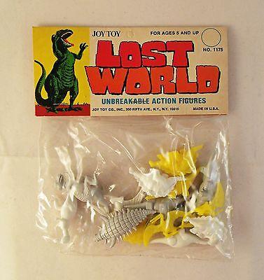 Vintage 1960s Set of 4  Dinosaurs Sealed with Hang Tag Made in Hong Kong