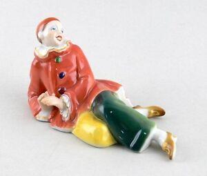 9941012-Porcelain-Figurine-Pierrot-Harlequin-Lying-Ens-14x8-CM