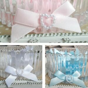 Details about 10 X Satin Ribbon pre-tied bows with pearl heart centres Baby  Pink Blue White