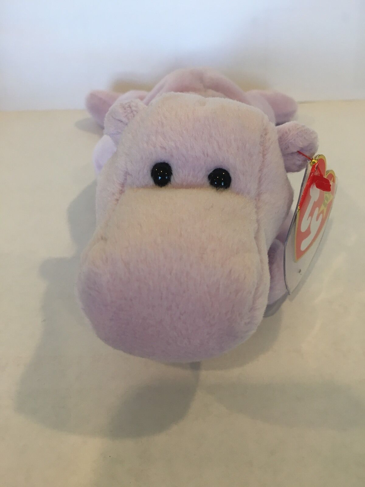 Happy The Hippo Ty Beanie Baby. He Is Rare, New, MWMT and P.V.C. Pellets.