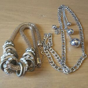 Two lovely necklaces in silver tone and gold tone.