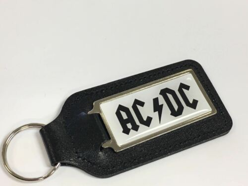 Acdc fond blanc /& noir écriture oblong porte-clés avec un dôme autocollant