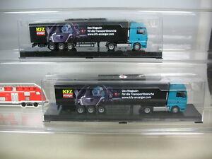 O773-0,5# 2x AWM H0 MAN TGX LKW/Lorry/Model KFZ indicator, NIP