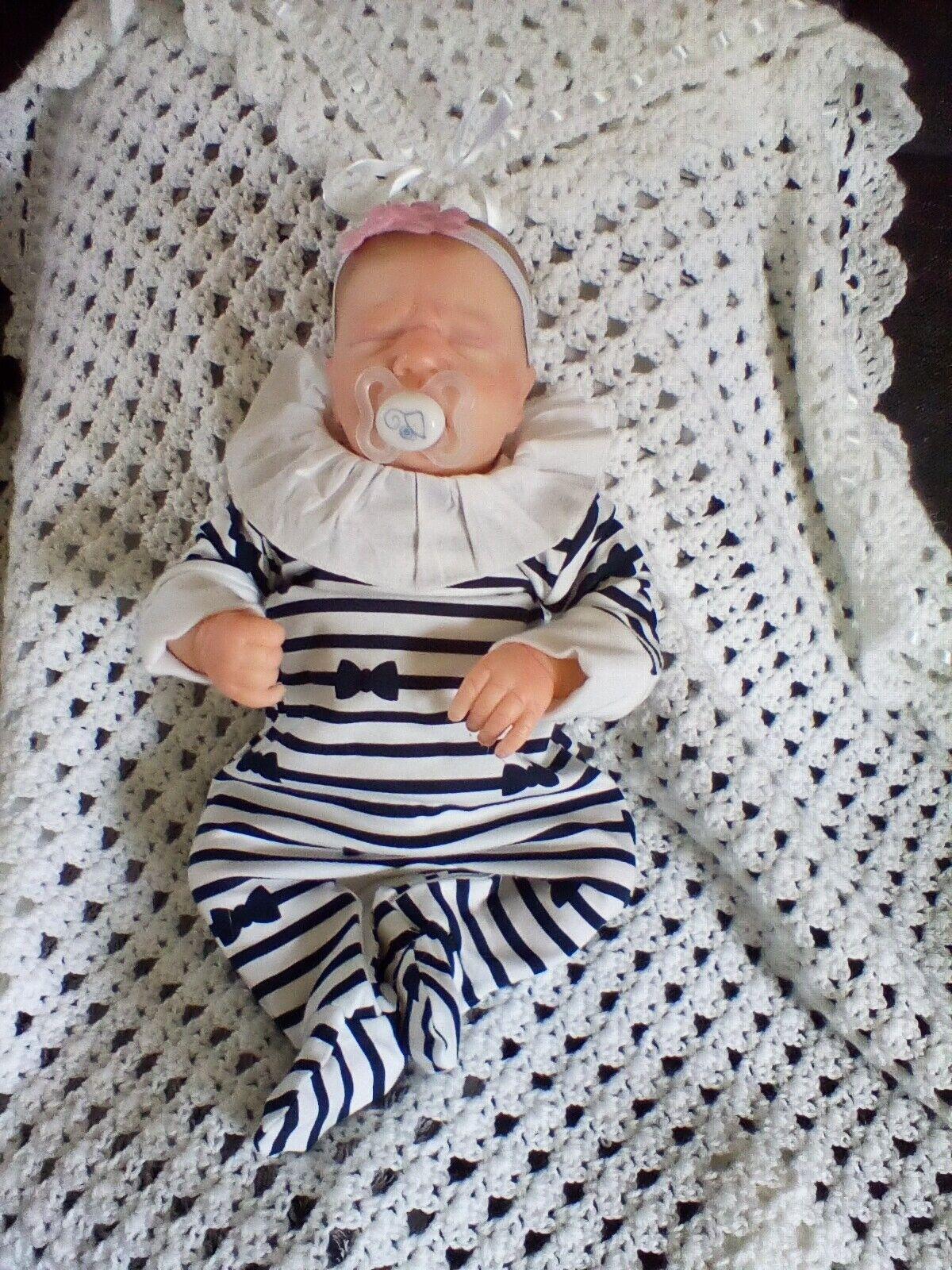 Beautiful reborn baby girl from the Realborn Blake kit
