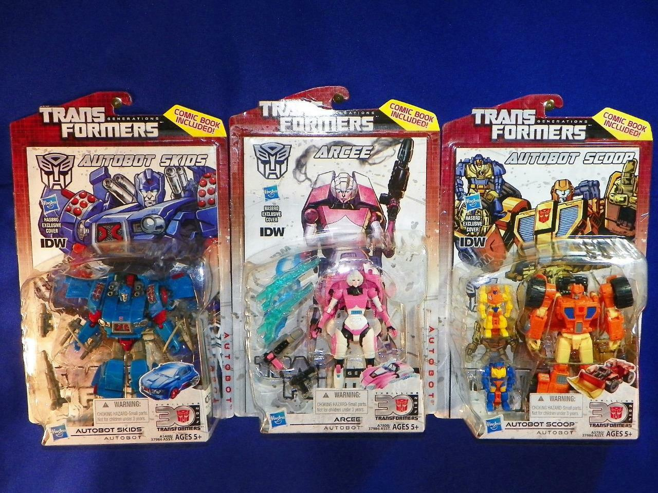 TRANSFORMERS 2014 IDW 30th Deluxe Arcee Autobot Skids Targetmaster Scoop Lot NEW