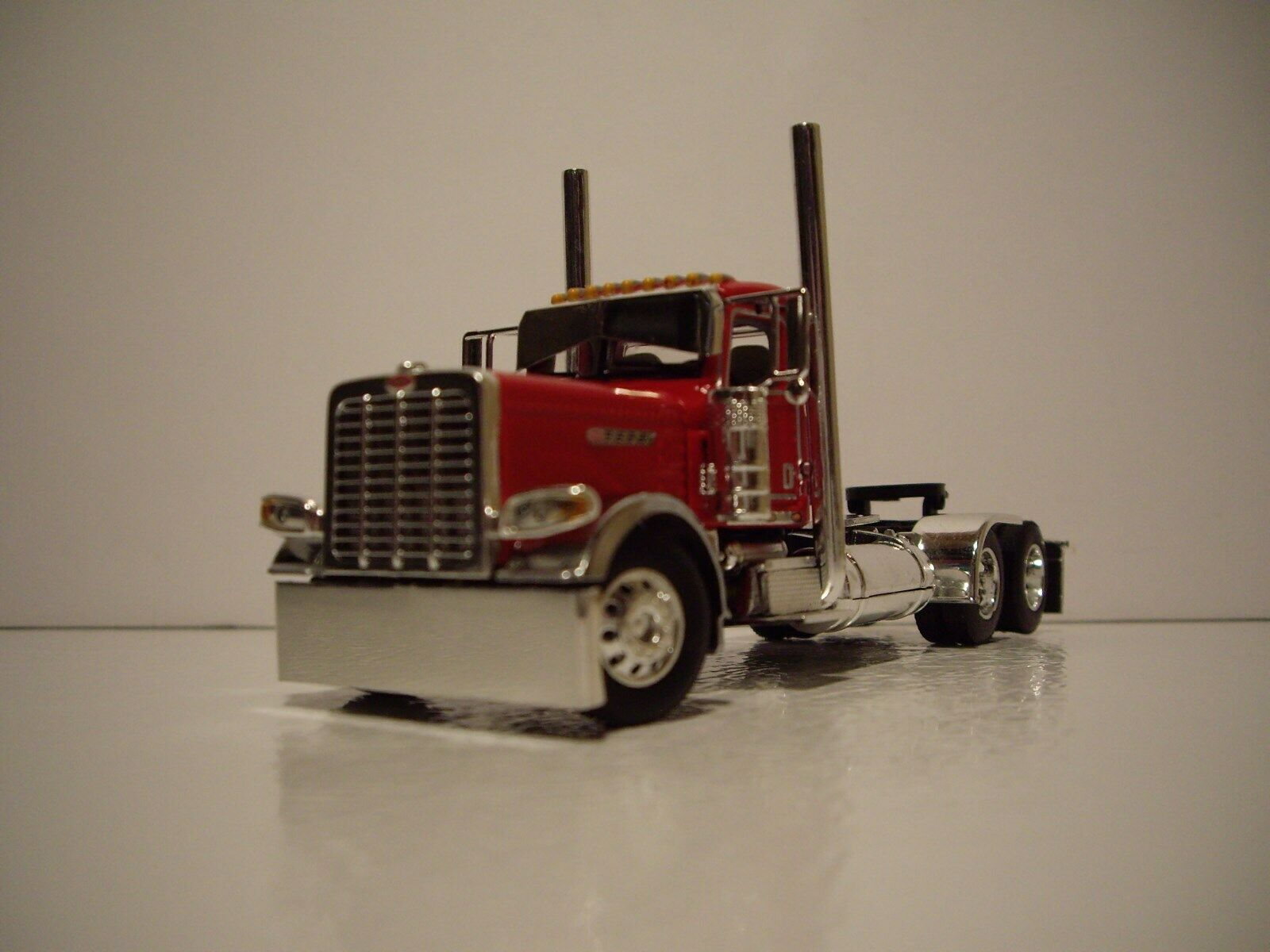 DCP FIRST GEAR 1 64 RED RED RED PETE 389 PRIDE N CLASS DAY CAB WITH SPREAD AXLE FLATBED 7a22ec