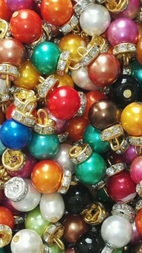 20 FOR £2.00 ONLY MULTI COLOURED PEARL BUTTONS WITH GOLD 1.5CMS IN LENGTH.