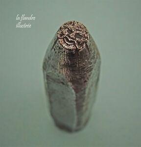 petit-burin-d-039-estampe-en-fer-forge-figurant-une-tete-humaine-poincon