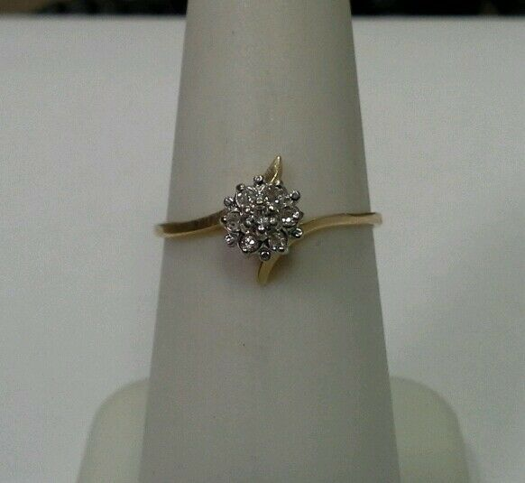 10k Yellow gold Ring with .05tcw 1 20 Diamond Cluster Size 6.25