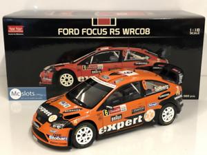 Ford-Focus-Rs-WRC08-H-Solberg-I-Minor-2010-Echelle-1-18-Sunstar-3952