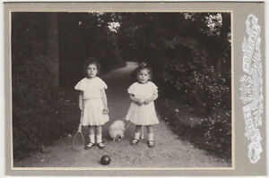 Original-1907-CC-two-girls-with-dog-and-racket