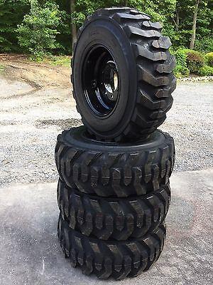 4 NEW 12-16.5 Deestone Skid Steer Tires on Black Wheels/Rims -12X16.5-12 ply