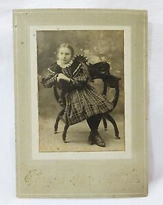 Antique-photograph-cabinet-card-girl-child-in-plaid-dress-sitting-on-chair-1897
