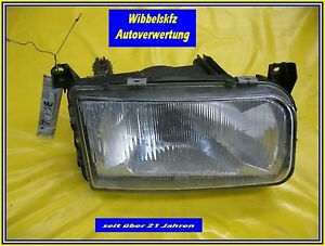 VW-Passat-35i-Hella-Frontscheinwerfer-links-Fahrerseite-1-Halter-gebrochen