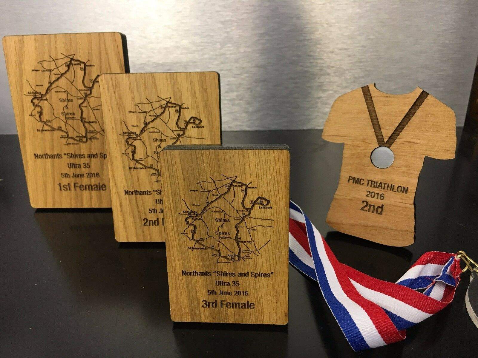 Bespoke Wooden Running Trophies, Made and engraved to your own design
