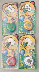JUEGO DE MANO LCD TAMAGOTCHI Dinkie Dino- lote de 4 unidades